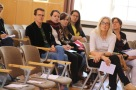 Faculty members and students of the North American Studies Program listen intently